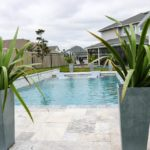 gradual entry pool with lounge chairs