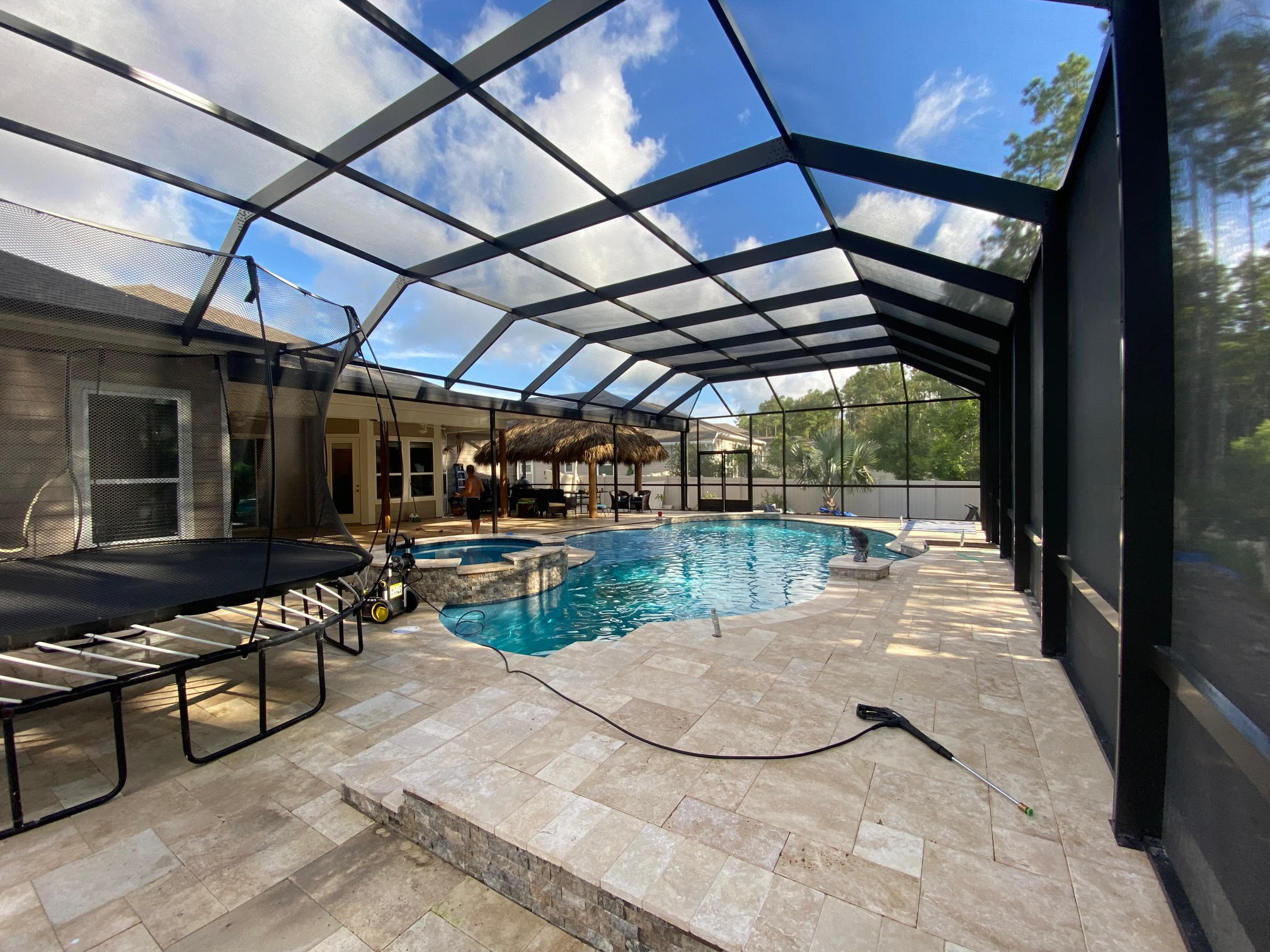 pool and spa combo screen enclosure waterfall water feature