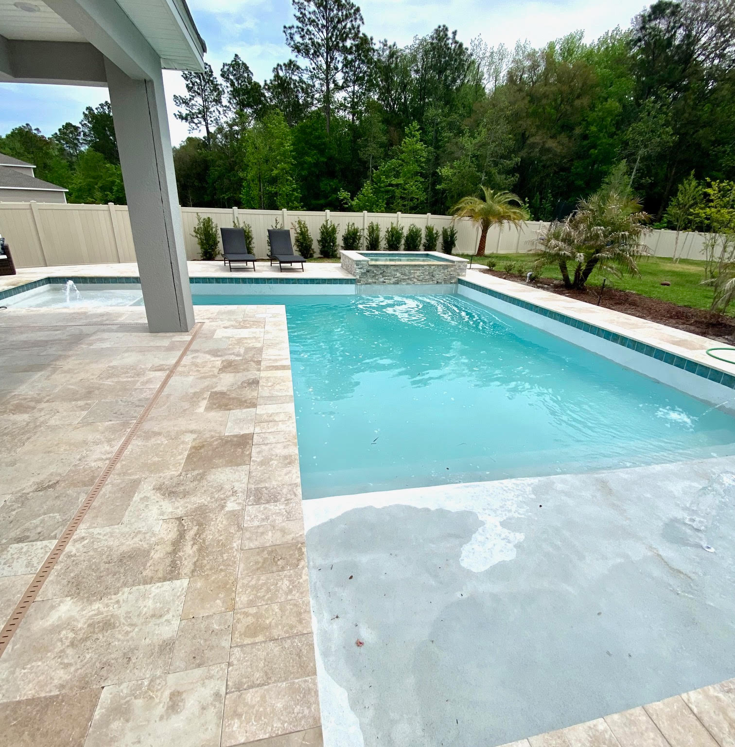 pool and spa combo sun shelf water feature